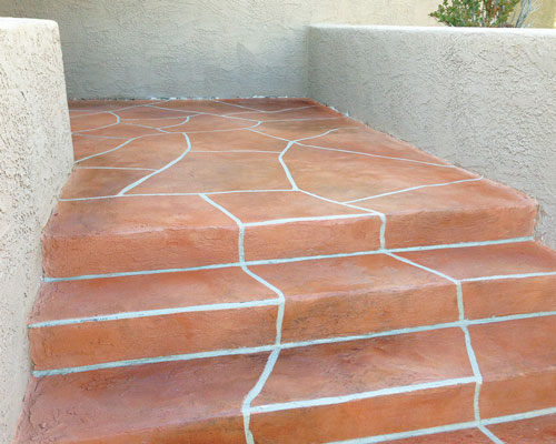 Concrete Overlay   A thin cement application over an existing concrete or other surface (to cover up imperfections or enhance existing surface) which can be coloured, acid stained, stamped or stencilled.