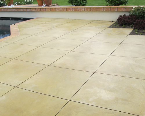 Coloured Concrete   A process by which dry colour additive is integrated with wet concrete resulting in consistent colour throughout.