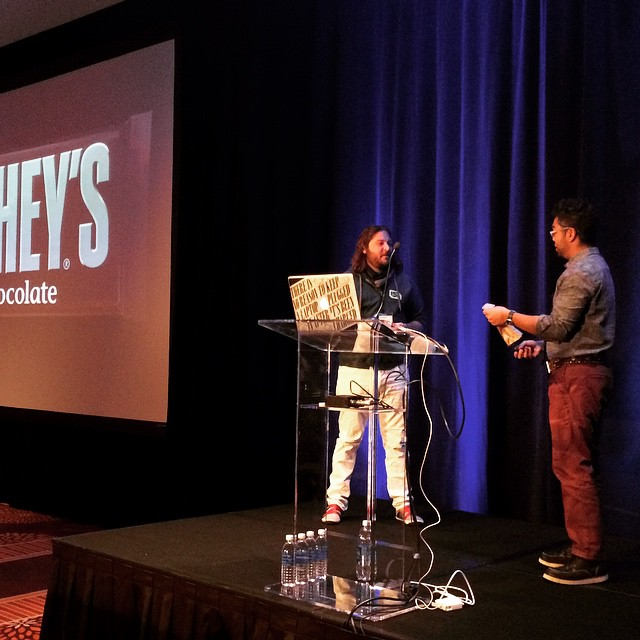 Dan Mall trying to convince a volunteer to buy a Hershey bar for $50. #ownersummit by ownersummit.jpg