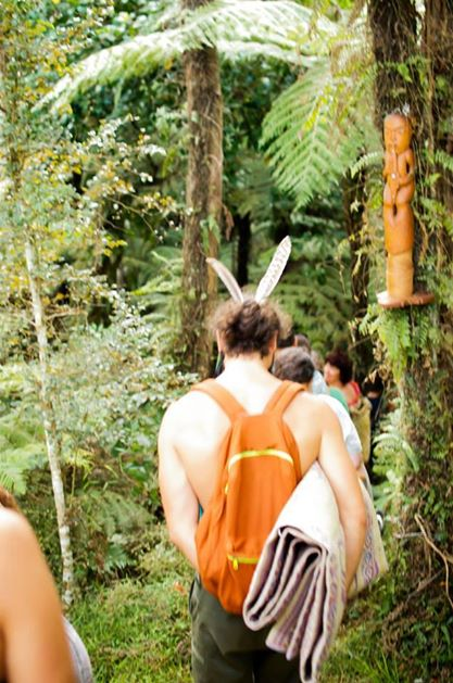 An image from the 2014 Whare Tapere - entering into the bush storytelling site of Waikaha, Waimangō.