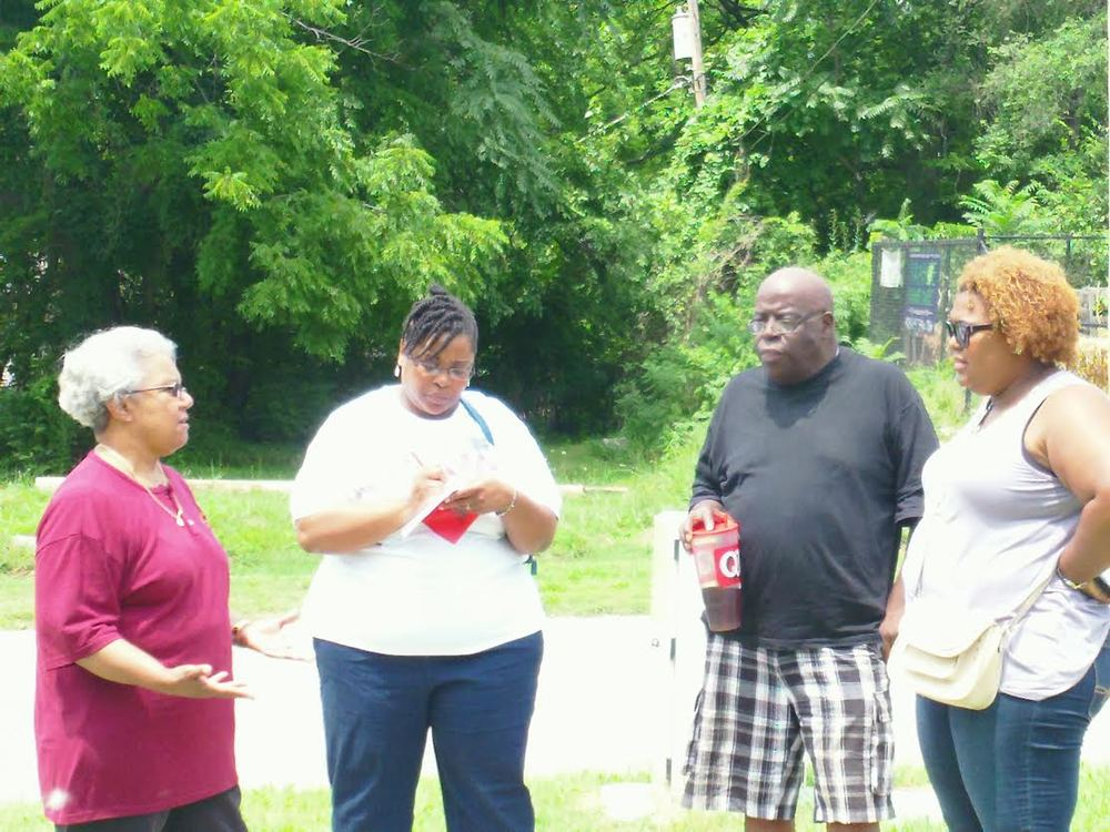 nona boards member speaking with Ms. may (executive director) ivanhoe Neighborhood council Kansas city, Missouri