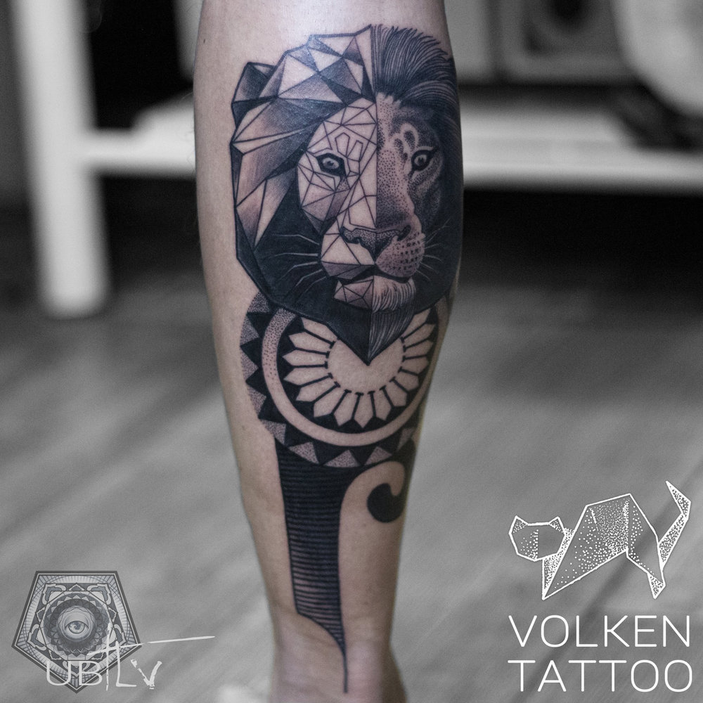 Black work geometric lion.jpg