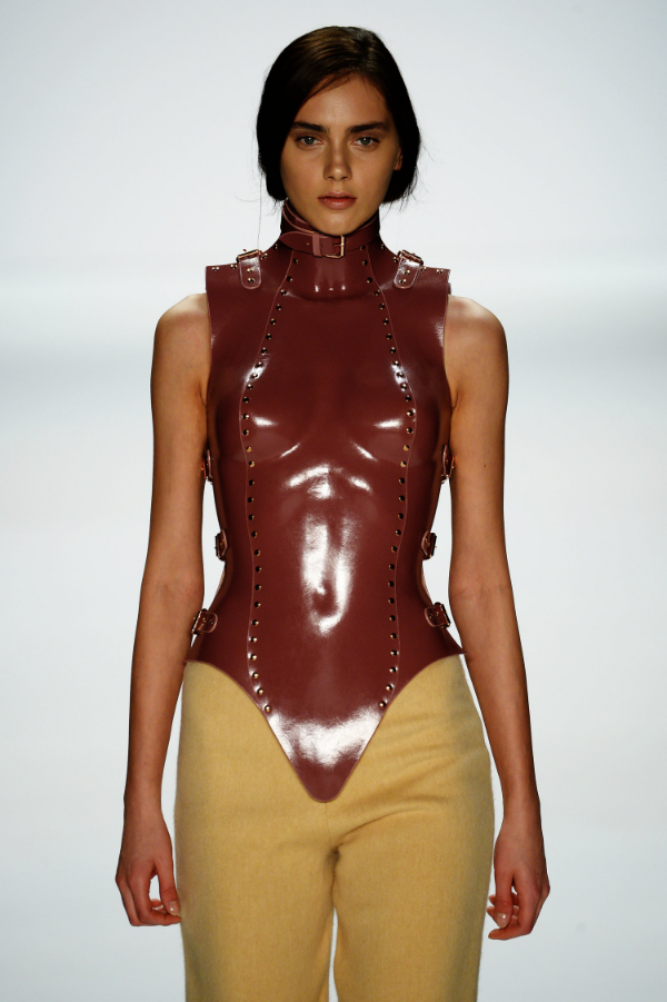 Model flaunts a molded latex corset from the Marina Hoermanseder S/S 2015 Collection  Image Courtesy WGSN