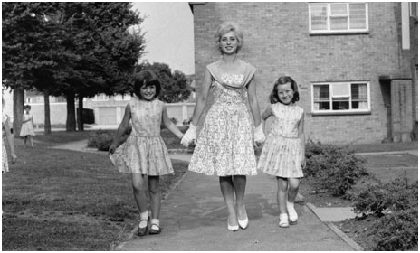 A happy 1950s family enjoying the benefits of life in a UK new town.  The new towns eventually returned a substantial dividend to the UK treasury, because the land had been publicly acquired at rural value.  (photo source:  the Guardian newspaper)