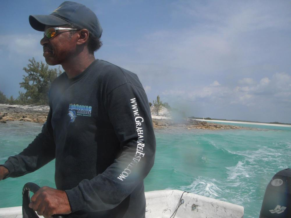 Our Bahamian partner Earl at the helm of his skiff.