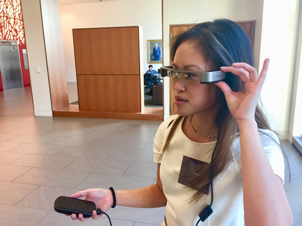 At a conference trying on an AR headset.