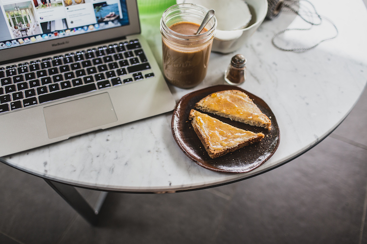 """Izy says: """"Me taking a Pinterest break and a snack of cinnamon-sprinkled toast with nut butter & jam, and coffee topped with more cinnamon!"""""""