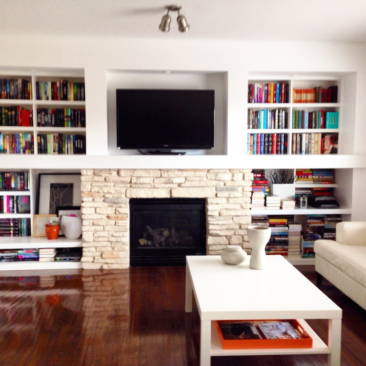 Color-packed bookshelves in the home of Joy, who blogs at Joyous Reads.