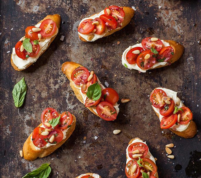Tomato and basil crostini via Drizzle & Dip