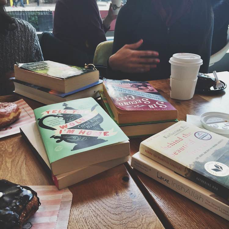 Swapping books over donuts and coffee at Stan's Donuts in Chicago.