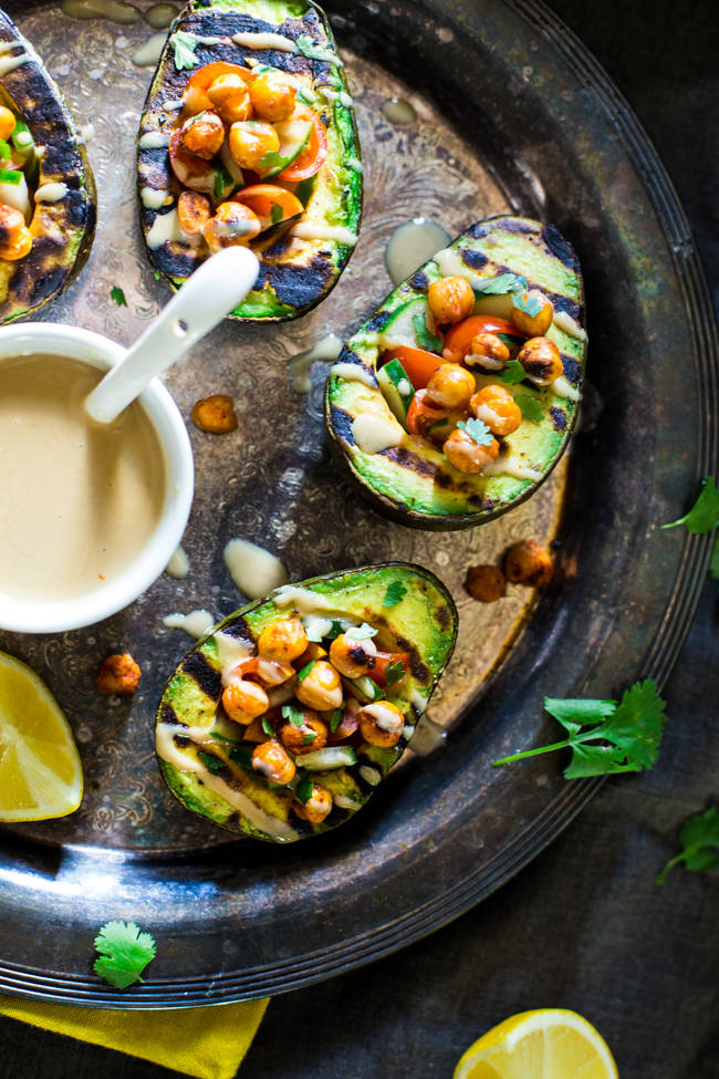 Vegan grilled avocado stuffed with chickpeas and tahini from Food Faith Fitness