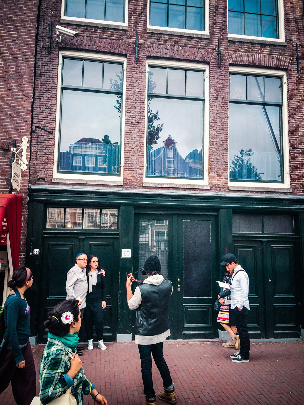 Anne Frank House - The line was crazy long to get in, so we just breezed past to see it. This was a particularly beautiful moment, The couple of the left is taking a photograph while their children on the right read from the Torah. I'm not sure why this moment was so striking to me but it'll stay with me forever.
