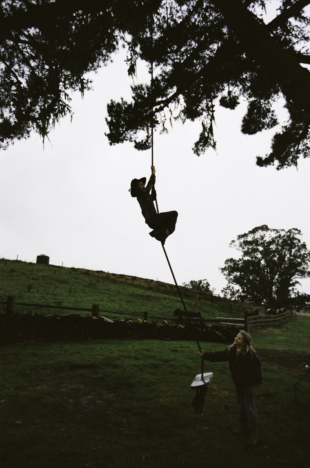 Larry, one of four kids, climbs the swing while his sister, Quill, watches. - San Gregorio, CA