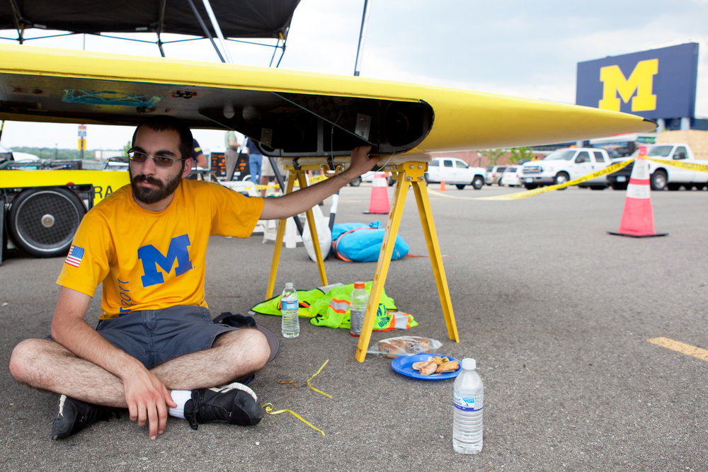 Solar car teams competing in the American Solar Challenge make a control stop at Michigan Stadium in Ann Arbor, Michigan