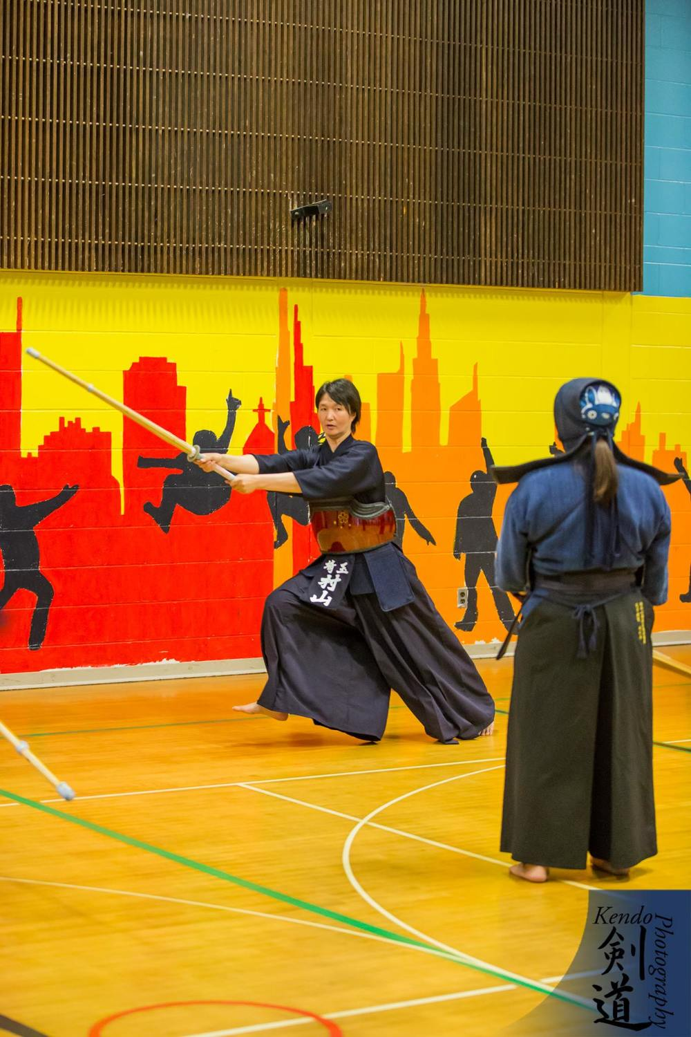 At the seminar: Murayama sensei demonstrates how to strike men.  Photo by event photographer Kendo Photography (Seattle).
