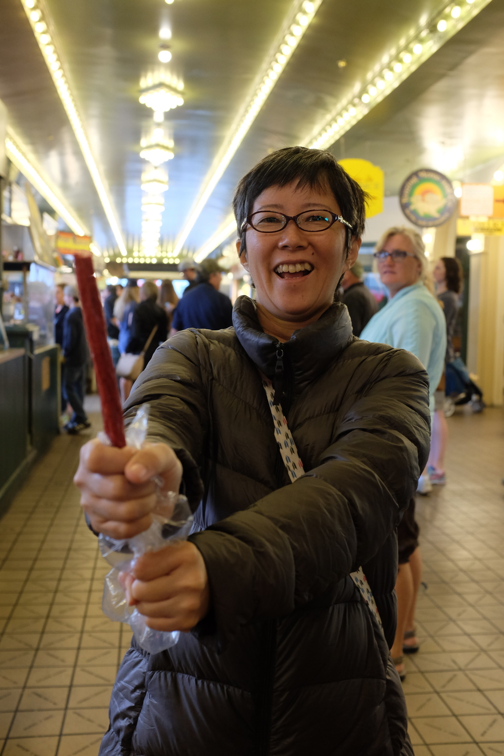 Reiko at Pike Place Market, making believe her beef stick is a shinai. :-(  Photo by Shishido.