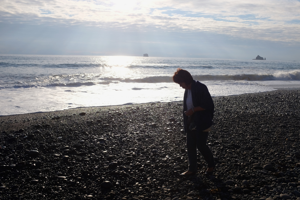 Gayle looking for rocks at sunset, Rialto Beach, Olympic National Park.  Photo by Shishido.