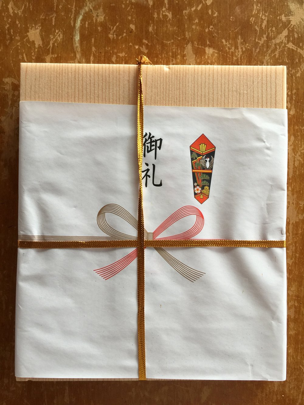 These sweets were sent to us as a 'thank you' from Mr. Shinji Sasaki. I met him while he was here in Hawaii, practicing kendo at Kenshikan while taking English classes here at the University of Hawaii. His story is an interesting one. After not doing kendo for a very long time (several decades?), he returned to kendo a few years ago and started training in preparation to take his 6-dan exam. He recently passed his 6-dan exam this past April in Kyoto, at 78 years old. It is an amazing accomplishment. Congratulations to Mr. Sasaki!