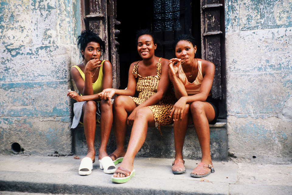 three girls sitting in the streets of  havanna, cuba 1999