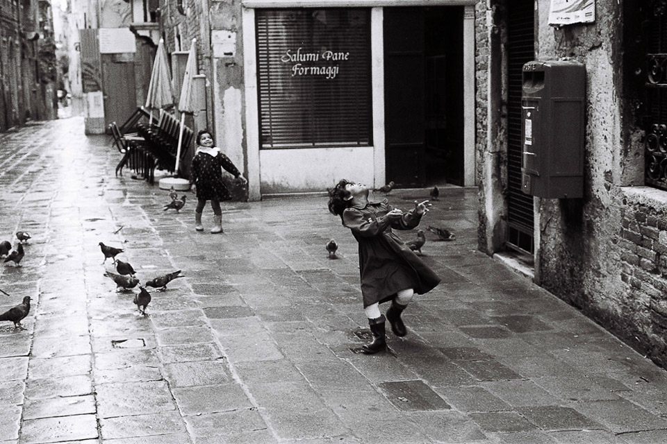 girls playing with doves, venice 1993