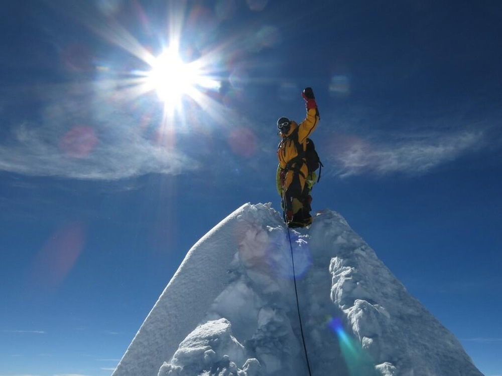 the very definite peak of manaslu, so small only one person can stand on it at a time.