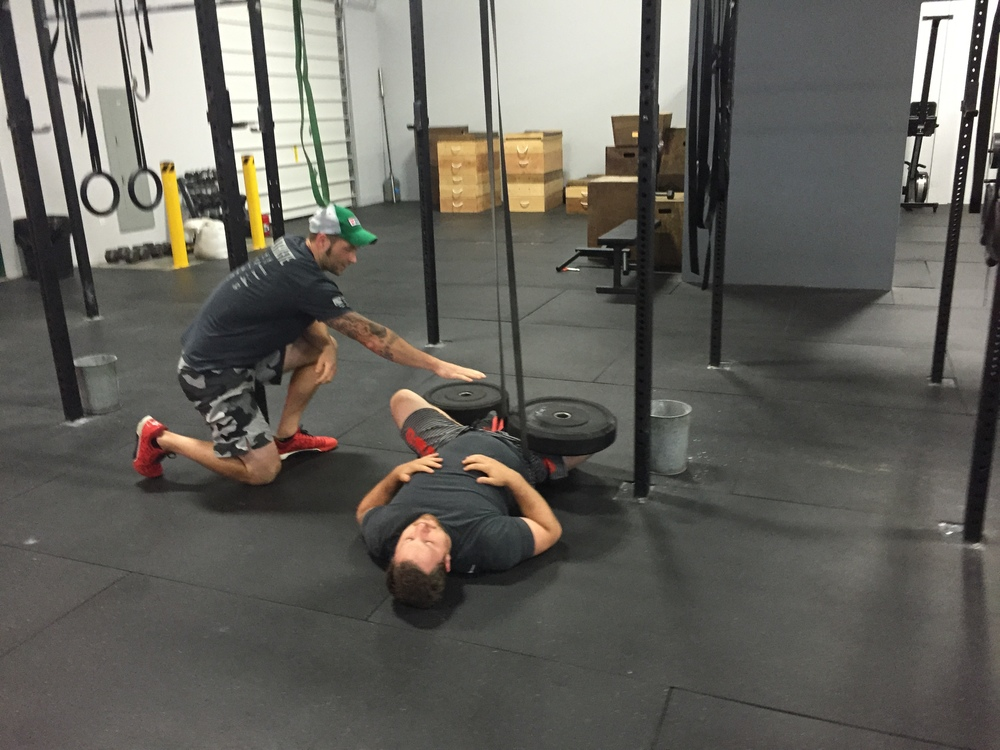 Coach Josh working with Jason on mobility.