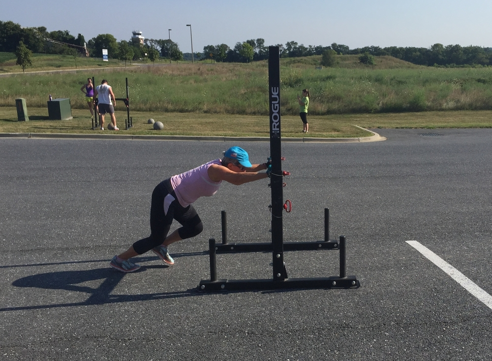 Margaret, pushing the prowler during a Strongman workout.