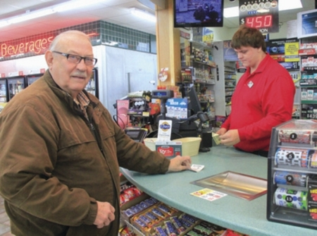 Jack Armstrong, left, purchases a few chances from store clerk Robert Ward at the OnCue Express store on North 14th Street in Ponca City.