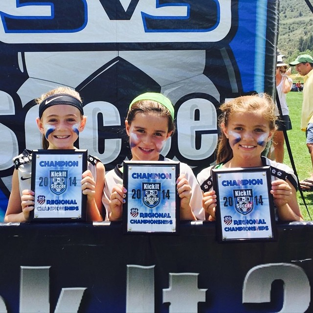 KickIt Girls Soccer Champions Unite as a Team wearing isplack blue and white eyeblack