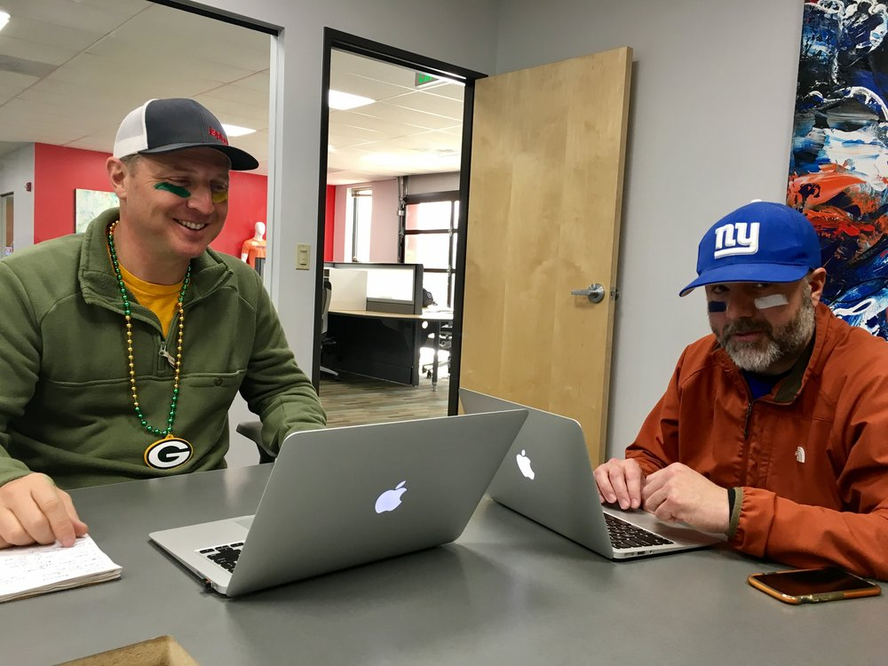Green Bay Packers fan and isplack's VP of Sales, Peter Zana is all smiles today, while New York Giants fan and isplack's COO, Aaron Beach looks on to the next season.
