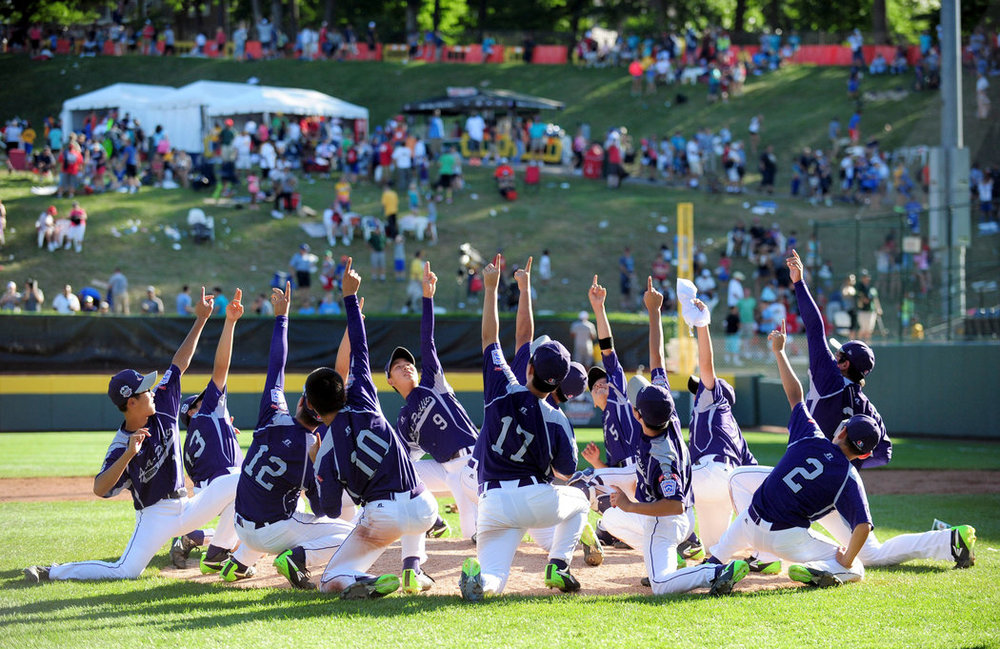 The South Korea Little League team celebrating their 2014 World Series Title win.