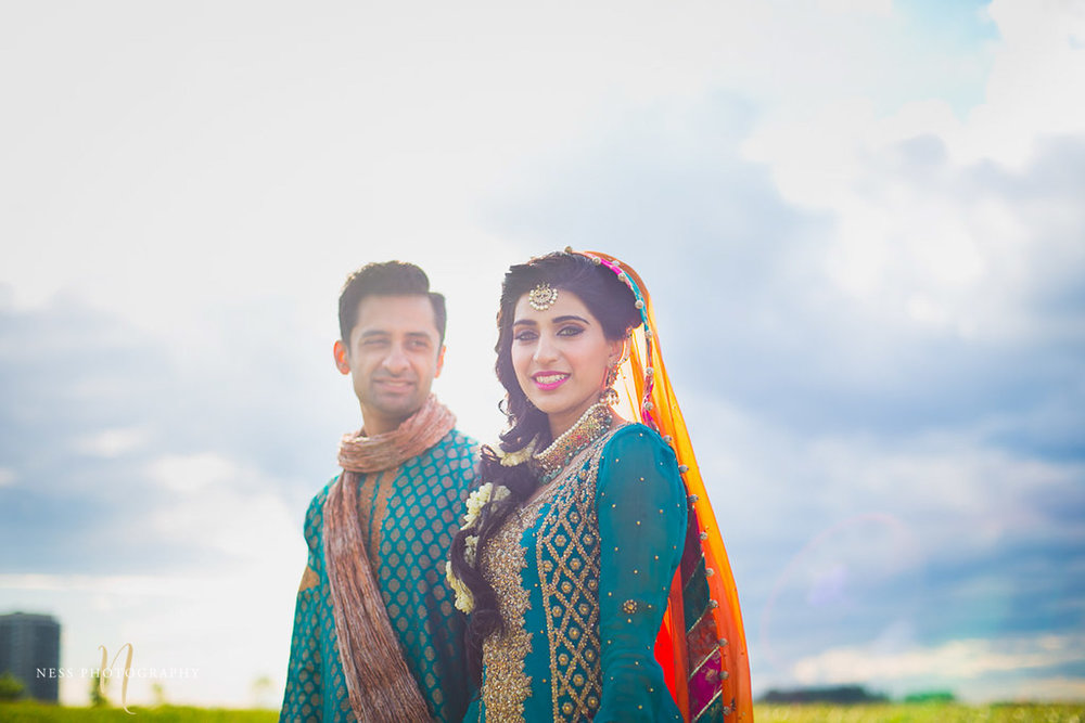 pakistani bridal portrait with the sky in the background