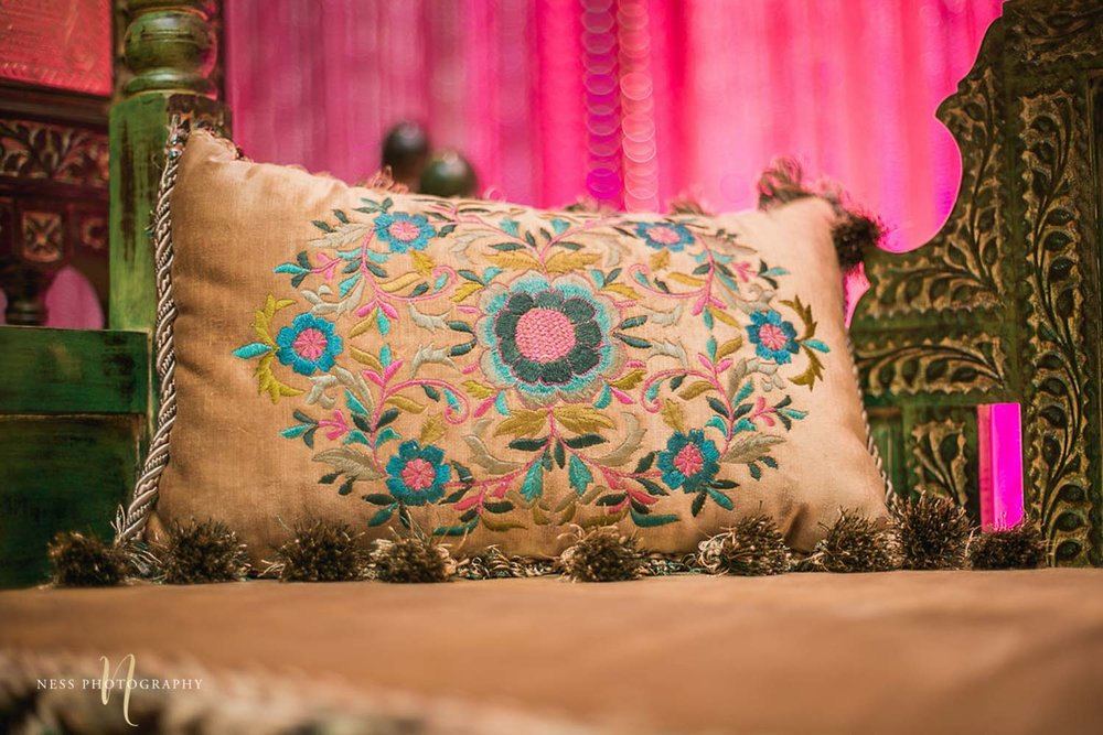 green embroidered pillow at pakistani mehendi decor in ottawa