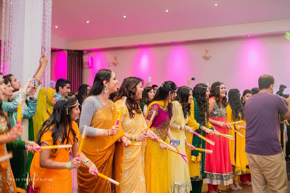 bridesmaids play dholdki in yellow at mehendi in ottawa