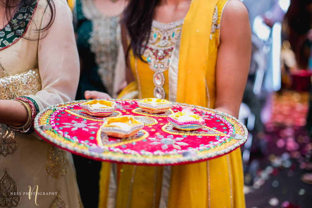 candles on tray at pakistani mehendi