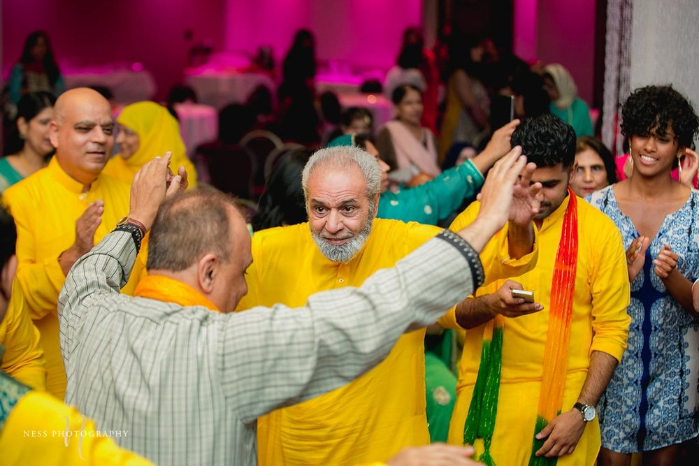 grandpa in yellow sherwani dancing at the pakistani mehendi in ottawa