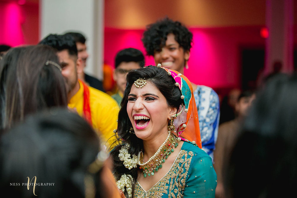 bride in bleu lehenga dancing and laughing at mehendi in ottawa