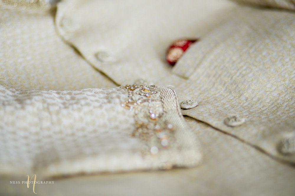 pakistani groom sherwani laying flat on the bed with closeup in sleeves for ottawa nikkah day