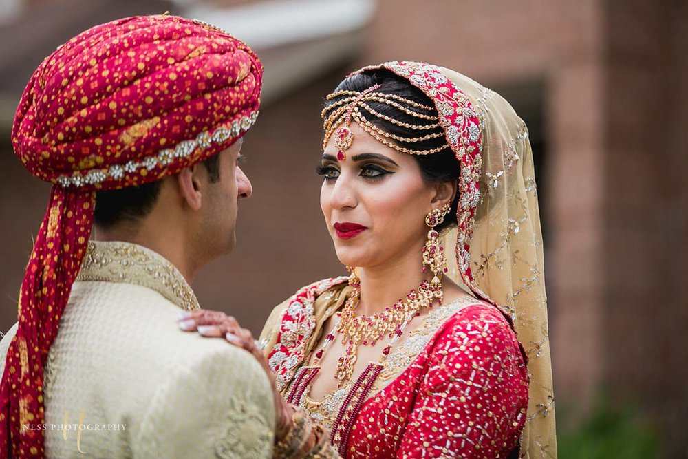 bride getting emotional and crying as she sees the groom for the first time in first look of pakistani wedding
