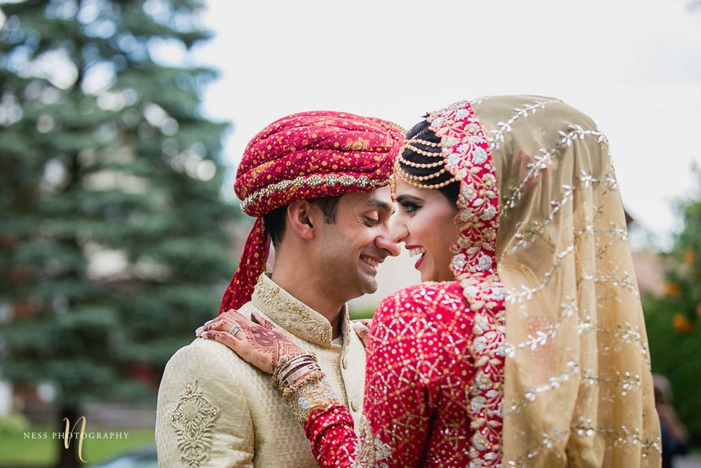 pakistani bride hugging her groom and smiling after first look on nikkah day in ottawa