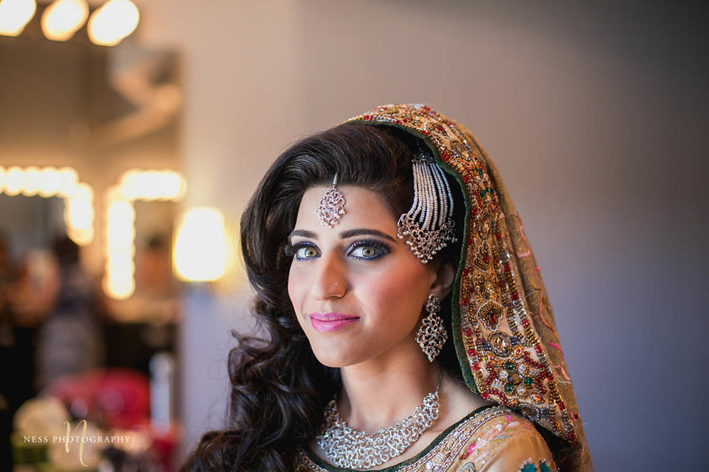 close up portrait of pakistani bride looking at thecamera and wearing dupatta at Shirley Wu beauty concept in toronto