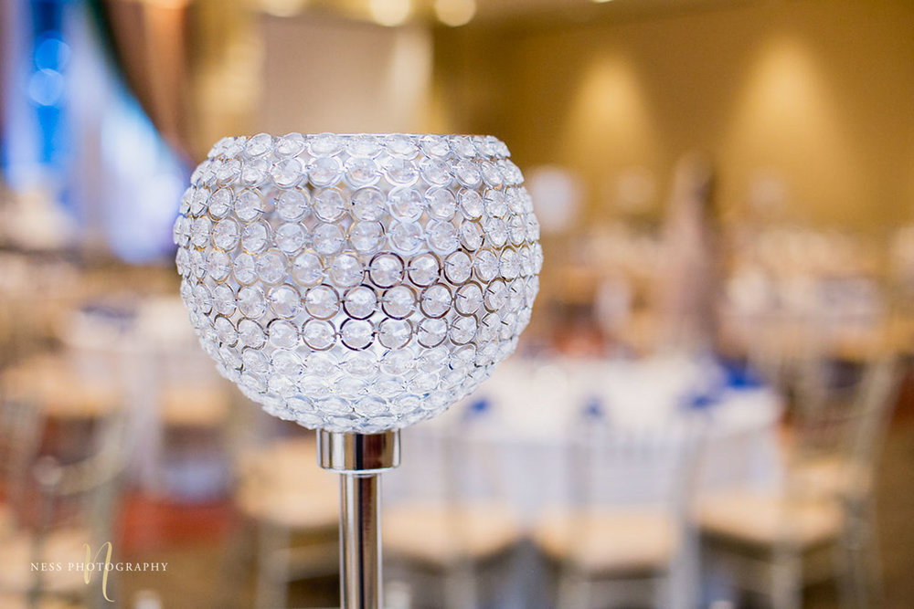 round crystal centerpieces on the table at walima reception in payal banquet hall