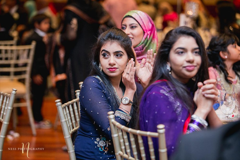 guests applaud after the speeches at pakistani walima reception at payal banquet hall