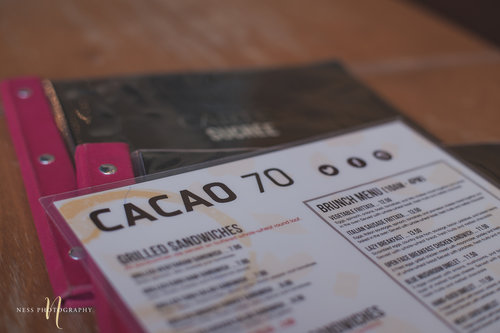 closeup of cacao70 menu during an engagement photoshoot