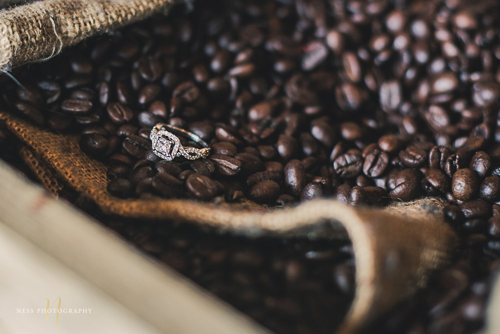 engagement ring in the middle of sack of coffee beans at cacao70 photoshoot