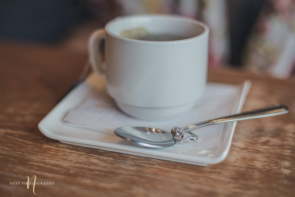 engagement ring next to coffee  spoon during engagement photoshoot at cacao70 montreal