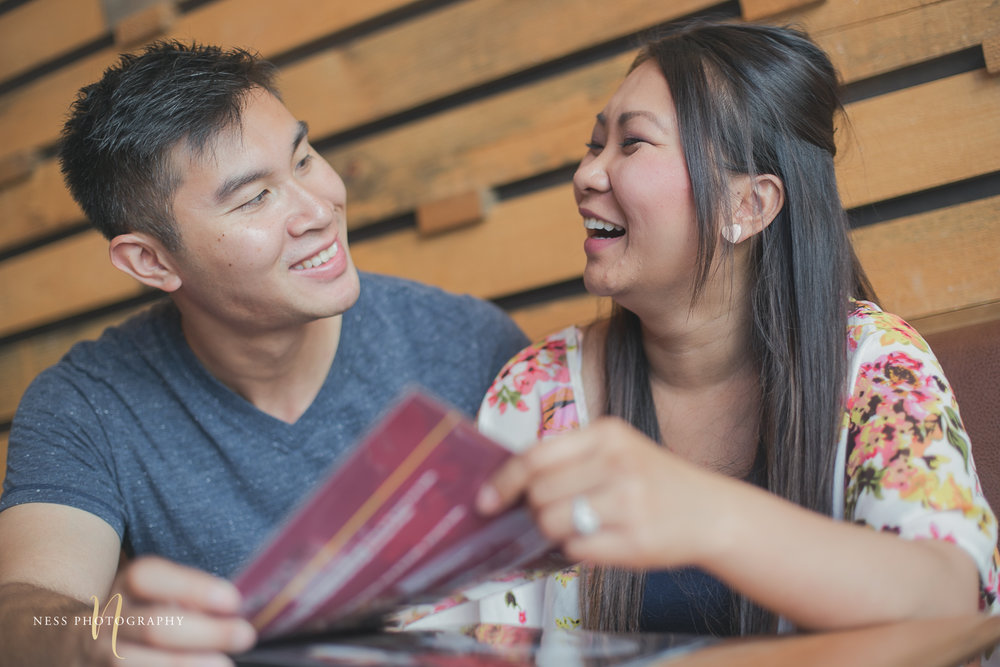 couple laughing while looking at the menu at cacao70 montreal