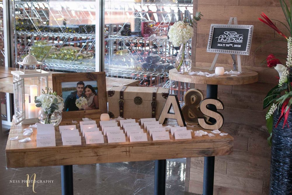 wooden table decor at entrance with save the date sign at  engagement Party in Montreal