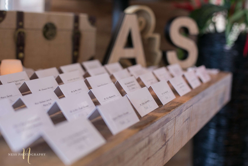 place cards with couple's initials behind at engagement Party in Montreal