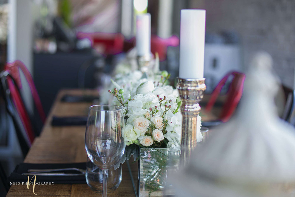 white flowers and brass candle holders at engagement Party in Montreal